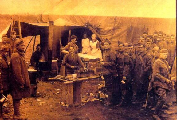 Salvation Army workers serving fresh doughnuts to American doughboys just in from the Meuse-Argonne front, October 12, 1918